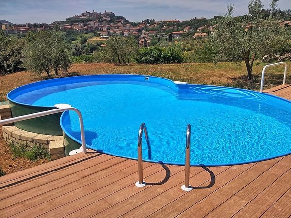Private pool at Villa Corolle, with views towards Montepulciano